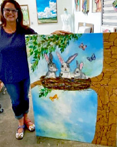 Lisa Morales shows her painting The Secret Life of Rabbits